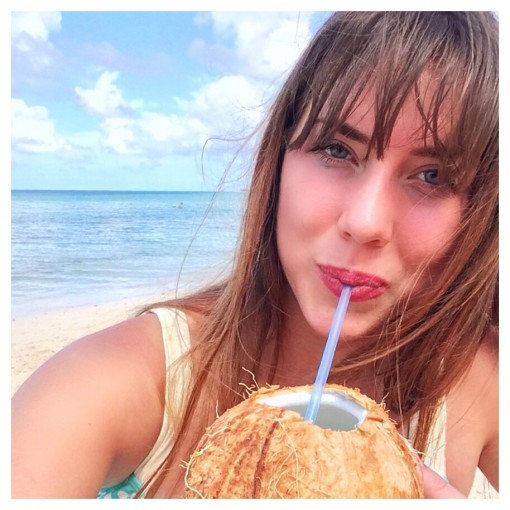 Drinking young coconut water on the beach